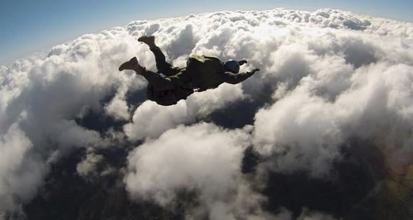 Skydiver pictured in the sky from above